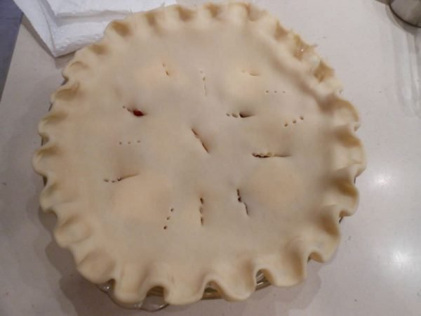 Cover pie with top and make slits